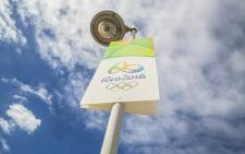A poster promoting the Rio 2016 Olympic Games hangs from a streetlight on the streets of Rio de Janeiro. Picture: Reinart Toerien/EWN.