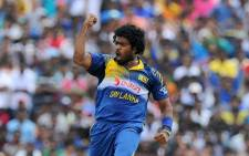 Sri Lankan cricketer Lasith Malinga celebrates after he dismissed Pakistan batsman Mohammad Hafeez during the third and final One Day International (ODI) between Sri Lanka and Pakistan, 30 August, 2014. Picture: AFP.