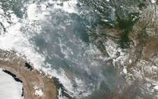 This photo obtained from Nasa shows a natural-color image of smoke and fires in several states within Brazil including Amazonas, Mato Grosso, and Rondônia was collected by NOAA/Nasa's Suomi NPP using the VIIRS (Visible Infrared Imaging Radiometer Suite) instrument on 20 August 2019.  Picture: AFP