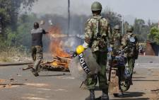 FILE: Kenyan police officers are deployed in the slum of Kisumu where an angry mob started setting up road blocks and rioting on the streets after the declaration of the presidential elections on March 9, 2013.  Picture: AFP/ TILL MUELLENMEISTER