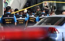 Forensic police prepare to enter the Terminal 21 mall, where a mass shooting took place and the gunman is currently still hiding, in the Thai northeastern city of Nakhon Ratchasima on 9 February 2020. Picture: AFP