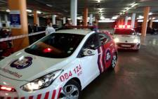 Paramedics attending to a wounded guard at the Forest Hill Mall in Centurion after an attempted robbery. Picture: @ER24EMS.