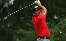 Koumei Oda of Japan hits his tee shot on the ninth hole during the third round of the 96th PGA Championship at Valhalla Golf Club on August 9, 2014 in Louisville, Kentucky. Picture: AFP.