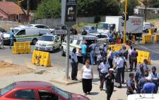 Police at the scene where they accosted a group of robbers trying to make a quick getaway on the N1 north on 30 October 2014. Picture: Ryan James/iWitness.
