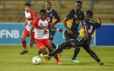 The University of Pretoria and University of KwaZulu-Natal players in action during their Varsity Football match. Picture: Ahmed Kajee/EWN.