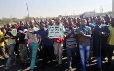 FILE: Amplats workers in Rustenburg during a wage strike in 2012. Picture: EWN.