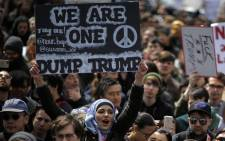 People take part in a protest against Republican presidential candidate Donald Trump, on 19 March, 2016 in New York City. Picture: AFP.