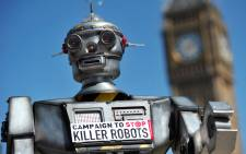 """A mock """"killer robot"""" is pictured in central London on April 23, 2013 during the launching of the Campaign to Stop """"Killer Robots,"""" which calls for the ban of lethal robot weapons that would be able to select and attack targets without any human intervention. Picture: AFP."""