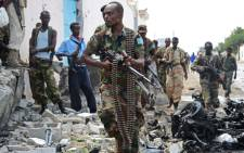 Somali National Government soldiers are pictured after Al-Qaeda linked Shebab insurgents shot and blasted their way into the United Nations compound in Mogadishu on June 19, 2013. Two South Africans were killed in the attack.  Picture: AFP