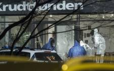 Forensic police officers work at the area around a cultural centre in Copenhagen, Denmark, where shots were fired during a debate on Islam and free speech on 14 February, 2015. Picture: AFP.