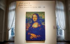 "The street art Rubik's Cube version of the ""Mona Lisa"" entitled ""Rubik Mona Lisa"" made in 2005 by French artist Invader is on display at the Artcurial auction house in Paris on February 3, 2020 before being auctioned next February 23rd. Picture: AFP."