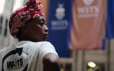 FILE: A Wits student stands inside Senate House on campus on 19 October 2015 during protests over a proposed fee increase for the 2016 year. Picture: Reinart Toerien/EWN.
