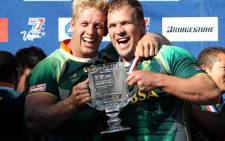 Kyle Brown and Frankie Horne celebrate their victory over Fiji in the Cup Final in Las Vegas on 13 February 2011. Picture: AFP