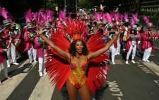 FILE:. Performers in costume take part in the carnival on the main Parade day of the Notting Hill Carnival in west London on 26 August 2019. Picture: AFP