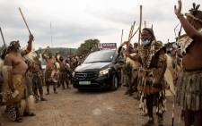 Amabutho (Zulu regiments) form a guard of honour as they escort a hearse carrying the body of King Goodwill Zwelithini from a mortuary in Nongoma, KwaZulu Natal on 17 March 2021. Picture: Phill Magakoe/AFP