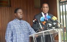 The former Ivorian president Henri Konan Bedie (L), president and presidential candidate of the Democratic Party of Ivory Coast (PDCI) and Pascal Affi N'Guessan (R), president and presidential candidate of the Ivorian Popular Front (FPI), speak to the press at the residence of Henri Konan Bedie in Cocody, Abidjan, on 15 October 2020. Picture: AFP