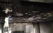 A lecture hall at Wits University has been set alight allegedly by students who have been protesting over fees. Picture: Kgothatso Mogale/EWN.