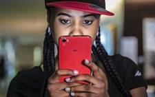 A woman holds the new AG #Hashtag phone inspired by South African rapper Cassper Nyovest. Picture: Reinart Toerien/EWN.