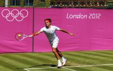 Tennis star Roger Federer practices for the Lodondon Olympics. Picture: LOCOG.