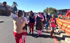 Dozens of disgruntled Mitchells Plain residents make their way to the police station during demonstrations for better police services in the area on 21 March 2018. Picture: Kaylynn Palm/EWN