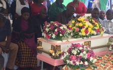 Evelyn Chauke's parents and family sit in front of her coffin at the little girl's funeral on 7 December 2016 in Alexandra. Picture: Kgothatso Mogale/EWN