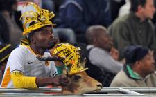 FILE: A Kaizer Chiefs fan with his springbok. Picture: AFP.
