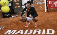 Serbia's Novak Djokovic poses with his trophy after winning the ATP Madrid Open final tennis match at the Caja Magica in Madrid on 12 May, 2019. Picture: AFP.