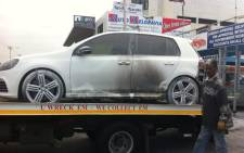 The vehicle which allegedly blew up at a car dealership on Belgravia Road in Athlone on 4 September 2014. Picture: Carmel Loggenberg/EWN.
