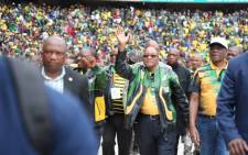President Jacob Zuma waves to the crowd upon as he arrives at Orlando Stadium ahead of ANC 105th anniversary celebration. Picture: Christa Eybers/EWN