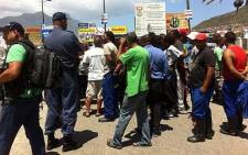 Fishermen protest outside the entrance to the Hout Bay Harbour on 29 January 2014. Picture: Siyabonga Sesant/EWN