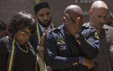 FILE: Dallas Police Chief David Brown prays during a a vigil at Thanks-Giving square in Dallas on July 8, 2016, following the shootings during a peaceful protest on July 7 which left 5 police officers dead. Picture: AFP.