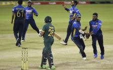 Sri Lanka's cricketers celebrate their victory by 78 runs at the end of the third one-day international (ODI) cricket match between Sri Lanka and South Africa at the R. Premadasa Stadium in Colombo on 7 September 2021. Picture: Ishara s. Kodikara/AFP