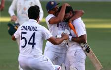 India's batsman Rishabh Pant (R) celebrates victory with teammates in the fourth cricket Test match against Australia at The Gabba in Brisbane on 19 January 2021. Picture: Patrick Hamilton/AFP