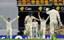 England's Dawid Malan (C) reacts to an unsuccessful lbw appeal against him off the bowling of Australia's Mitchell Starc on the first day of the first Ashes Test in Brisbane on November 23, 2017. Picture: AFP