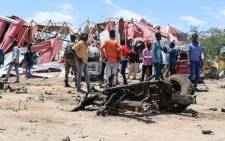 Bystanders gather at the site of a suicide car bomb explosion which targeted a European Union vehicle convoy in Mogadishu, Somalia, on 30 September 2019. Picture: AFP.