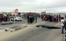 Residents of Joe Slovo Park near Milnerton blocked the road leading to the settlement in a previous protest. Picture: Malungelo Booi/EWN