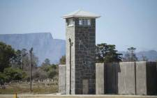 FILE: A view of a guard tower and Table Mountain behind some of the former prison buildings on Robben Island. Picture: RODGER BOSCH/AFP