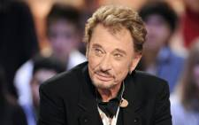 "FILES: In this file photo taken on March 28, 2011 French singer Johnny Hallyday attending a TV broadcast show ""Le Grand Journal"" on Canal + TV channel in Paris. Picture: AFP."