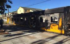 Peak hour commuters were sent scrambling after a train burst into flames at Retreat station on 10 December 2015. Picture: Natalie Malgas/EWN.