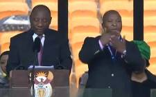 ANC deputy president Cyril Ramaphosa lead proceedings at FNB Stadium, with a sign language interpreter next to him on 10 December 2013. Picture: Picture: supplied.