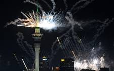 Fireworks explode over Auckland, New Zealand, during the opening of the Rugby World Cup on 9 September 2011. Picture: AFP