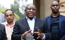FILE: South African President Cyril Ramaphosa (C) conducts a media briefing at the end of a meeting with various business leaders and political party leaders on matters relating to the COVID-19 outbreak at the Union Buildings in Pretoria on 22 March 2020. Picture: AFP