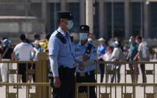 Police officers keep watch in Tiananmen Square in Beijing on 4 June 2021, the 32nd anniversary of the deadly 1989 crackdown on pro-democracy protests. Picture: Greg Baker/AFP