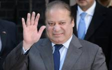 Pakistan's Prime Minister Nawaz Sharif waves to the media after a meeting at number 10 Downing Street in central London on 5 December, 2014. Picture: AFP.