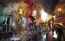 Firefighters battle the fire at a nightclub in Santa Maria, 550 Km from Porto Alegre in southern Brazil on 27 January 2012. Picture: AFP/Agencia RBS/Brazil Out