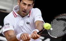 Serbia's Novak Djokovic returns a backhand to Spain's Alejandro Davidovich during their match of the Men's Italian Open at Foro Italico on 13 May 2021 in Rome, Italy. Picture: AFP.