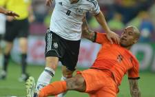 German midfielder Mesut Oezil (L) with Dutch midfielder Nigel de Jong during the Euro 2012 championships football match the Ntherlands vs Germany on 13 June.