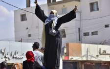 A Sudanese woman takes part in a protest in the city of Khartoum Bahri, the northern twin city of the capital, to demand the government's transition to civilian rule, on 21 October 2021. Picture: AFP
