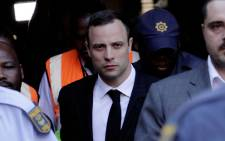 Oscar Pistorius leaves the High Court in Pretoria after day 21 of his murder trial on 11 April 2014. Picture: Sebabatso Mosamo/EWN.