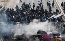 Police clash with protesters during a rally against a controversial extradition law proposal outside the government headquarters in Hong Kong on June 12, 2019. Picture: AFP